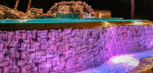 Inground pool with purple and blue LED lighting
