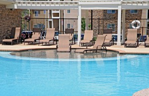 large pool tanning with two lounge chairs