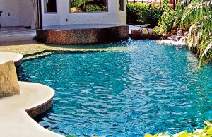 Zero beach entry swimming pool with spa and rock waterfall