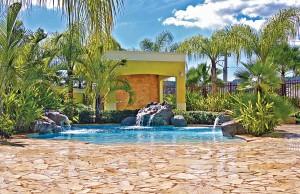 Zero beach entry swimming pool with rock waterfalls