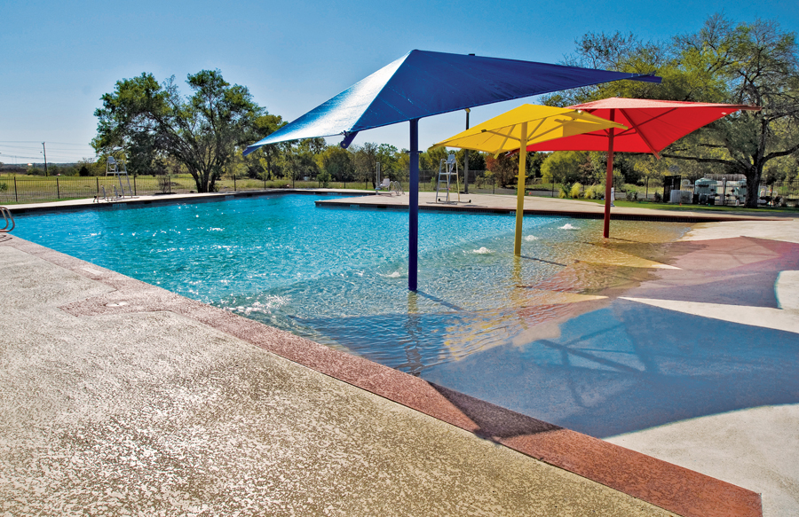 Large Beach Entry Swimming Pool With Shade Umbrellas
