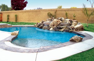 Zero beach entry swimming pool with rock waterfall