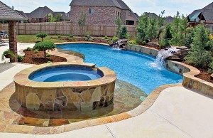 Zero beach entry swimming pool with tanning ledge and rock waterfalls