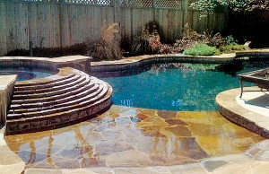 Zero beach entry swimming pool with waterfall steps