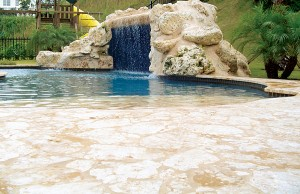 Zero beach entry swimming pool with rock waterfall grotto