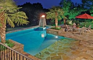 Zero beach entry swimming pool with fire pit and cascade waterfalls
