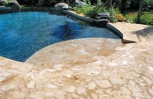 Zero beach entry swimming pool with vanishing edge