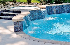Cascade waterfall pool feature with spa in the middle