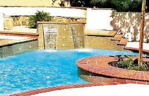 Multiple cascade waterfall features around pool