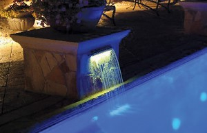 Lit cascade waterfall feature at night