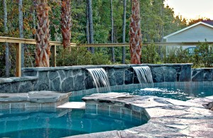 Two cascade waterfall pool feature with spa