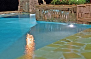 Cascade waterfall pool feature at night
