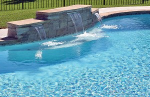 Tiered cascade waterfall swimming pool feature