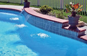 Small triple cascade waterfall pool feature