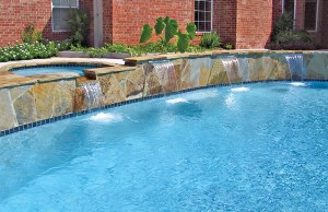 Cascade waterfall pool feature with spa