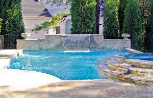 Cascade waterfall pool feature and spa