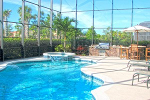free-form inground pool with spill over spa in Naples, Fl