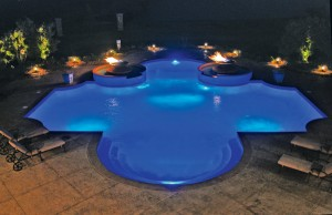 Geometric swimming pool with dual fire pits