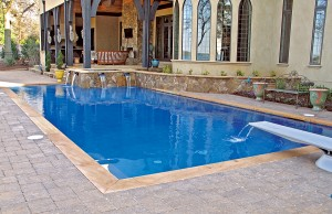 Geometric swimming pool with spa and diving board