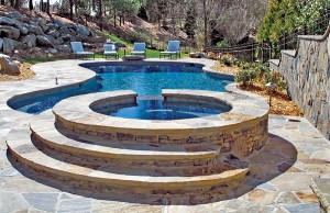 Gunite spa with rock steps