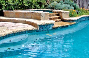 Gunite spa with waterfall steps