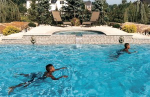 Gunite spa with boys swimming
