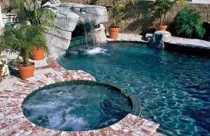 Gunite spa and rock grotto with cascade waterfall