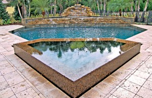 Geometric gunite spa with infinity edge