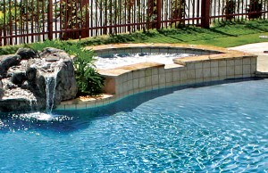 Gunite spa with rock waterfall
