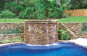 Raised gunite spa with cascade waterfall
