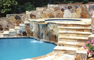 Gunite spa with rock steps and cascade waterfall