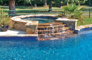 Gunite spa with rock waterfall steps