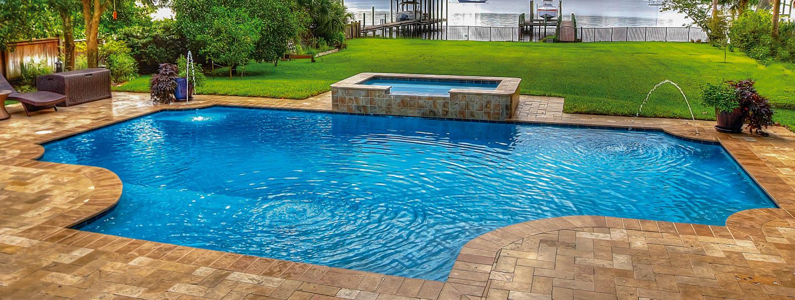 Jacksonville custom swimming pool builders blue haven pools for Custom inground swimming pools