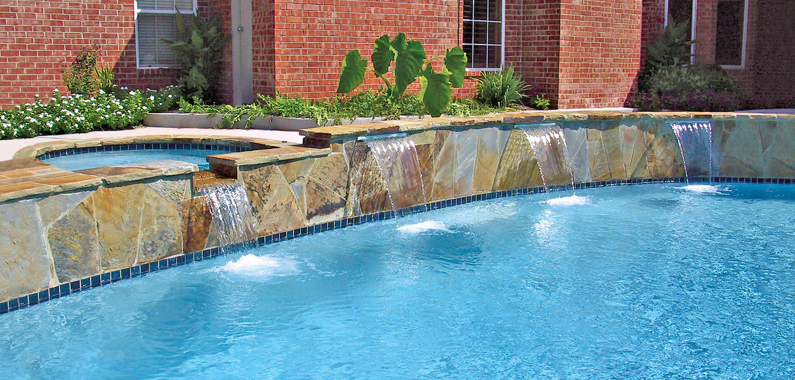 Cascade waterfalls blue haven custom swimming pool and for Pictures of a pool