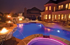 Swimming pool with fire pits and lighting