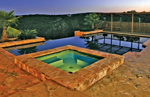 Vanishing edge swimming pool and spa with lights
