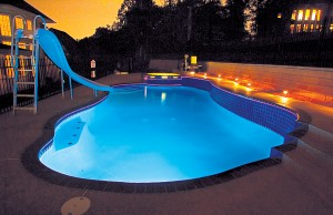 Swimming pool with color changing lights showing blue