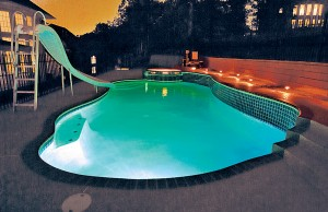 Swimming pool with color changing lights showing green