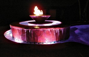 Swimming pool and fountain with color changing lights showing red