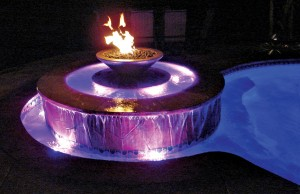 Swimming pool and fountain with color changing lights showing purple