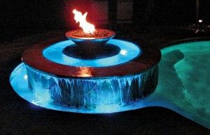 Swimming pool and fountain with color changing lights showing blue