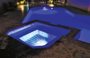 Swimming pool and spa with color changing lights showing white