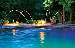 Swimming pool with color changing lights and laminar jets