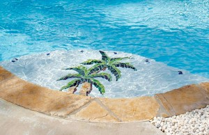Swimming pool with palm tree mosaic