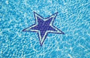 Swimming pool with Dallas Cowboys star mosaic