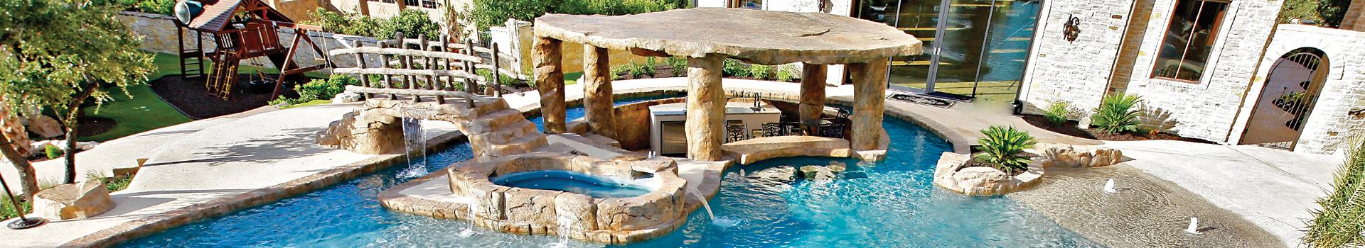 Pool with bridge and island kitchen
