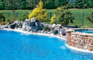Swimming pool with rock waterfall and spa