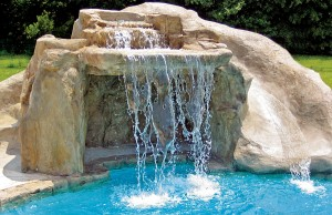Swimming pool with rock waterfall grotto and rock water slide