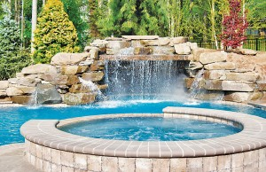 Swimming pool with rock waterfall grotto and spa