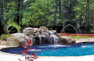 Swimming pool with rock waterfall laminar jets